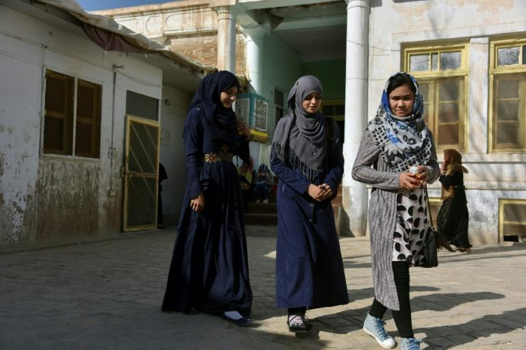 Across Afghanistan, women remain wary of the Taliban, desperate to see an end to the violence, but fearful of paying a heavy price (AFP Photo/JAVED TANVEER)