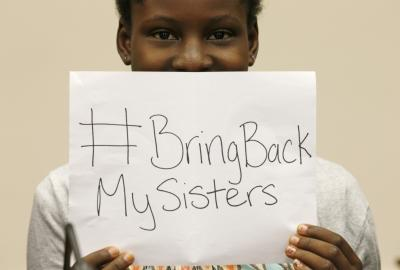 CLICK for slideshow: Nigerian teenager Deborah Peters, the sole survivor of a Boko Haram attack on her family in 2011, holds up a sign referring to the kidnapped Chibok secondary schoolgirls, while speaking to reporters on Capitol Hill in Washington May 21, 2014. Peters was on Capitol Hill to attend a hearing by the House Foreign Affairs Committee on Boko Haram: The Growing Threat to Schoolgirls, Nigeria, and Beyond. Deborah says she knows at least one of the kidnapped girls. (REUTERS/Kevin Lamarque)