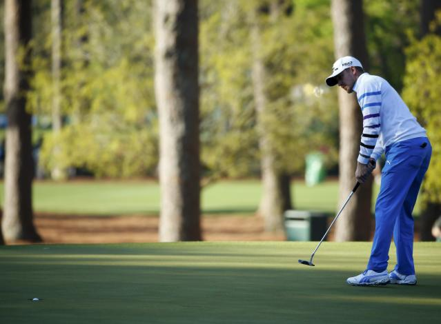 Sweden's Jonas Blixt sinks his birdie putt on the third hole during the first round of the Masters golf tournament at the Augusta National Golf Club in Augusta, Georgia April 10, 2014. REUTERS/Mike Blake (UNITED STATES - Tags: SPORT GOLF)