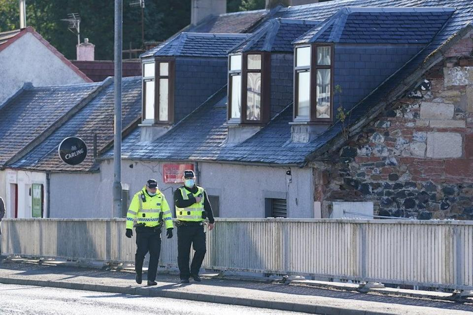 Police in New Cumnock, East Ayrshire, during the search (Andrew Milligan/PA) (PA Wire)