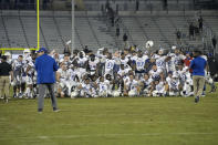 Tulsa players pose on the middle of the field after a win over Central Florida during an NCAA college football game Saturday, Oct. 3, 2020, in Orlando, Fla. Tulsa's win snapped UCF's 21-game home winning streak. (AP Photo/Phelan M. Ebenhack)