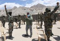 India's PM Modi gestures as he interacts with army soldiers during his visit to Himalayan region of Ladakh