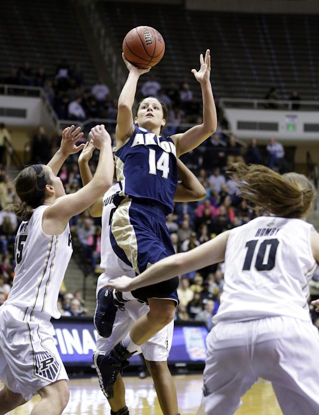 Akron guard Hanna Luburgh (14) shoots over Purdue guard Courtney Moses, left, and guard Hayden Hamby during the first half of a first-round game in the NCAA women's college basketball tournament, Saturday, March 22, 2014, in West Lafayette, Ind. (AP Photo/Michael Conroy)