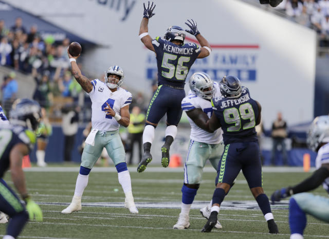 FILE - In this Sept. 23, 2018, file photo, Seattle Seahawks linebacker Mychal Kendricks (56) leaps as Dallas Cowboys quarterback Dak Prescott (4) attempts a pass during the second half of an NFL football game in Seattle. The Cowboys, who cant find anything remotely resembling a rhythm with quarterback Dak Prescott and a new group of receivers, are at home this week against the Detroit Lions. (AP Photo/John Froschauer, File)