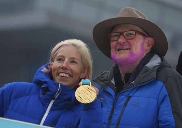 Twelve years ago, U.S. Ski & Snowboard Association official Tom Kelly promised cross-country skier Kikkan Randall that he would dye his beard pink if she ever won an Olympic medal. (AP Photo)