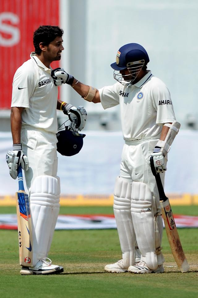 BANGALORE, INDIA - OCTOBER 11: Sachin Tendulkar congrajulates teammate  Murali Vijay (L) after he scored his first test century during day three of the Second Test match between India and Australia at M.Chinnaswamy Stadium on October 11, 2010 in Bangalore, India.  (Photo by Pal Pillai/Getty Images)