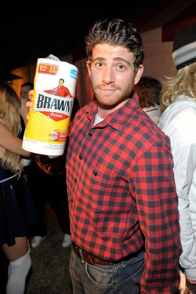 """<p>The party host will love you if you show up in this costume. Why? Because you can wipe up any spills or crumbs with Brawny paper towels a.k.a. your must-have accessory. </p><p><a class=""""link rapid-noclick-resp"""" href=""""https://www.amazon.com/Wrangler-Authentics-Sleeve-Fleece-Buffalo/dp/B00XH994ZI/?tag=syn-yahoo-20&ascsubtag=%5Bartid%7C10055.g.28089320%5Bsrc%7Cyahoo-us"""" rel=""""nofollow noopener"""" target=""""_blank"""" data-ylk=""""slk:SHOP PLAID SHIRTS"""">SHOP PLAID SHIRTS</a></p>"""