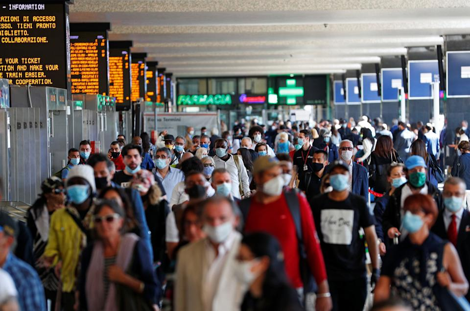 Passengers wearing protective face masks are seen at Rome's Termini train station as Italy relaxes more of its restrictions and allows free movement across the country to unwind its rigid lockdown due to the coronavirus disease (COVID-19) outbreak, in Rome, Italy June 3, 2020. REUTERS/Guglielmo Mangiapane (Photo: Guglielmo Mangiapane / Reuters)
