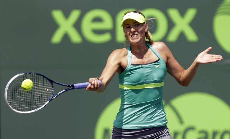Maria Sharapova, of Russia, returns to Elena Vesnina, also of Russia, during the Sony Open tennis tournament in Key Biscayne, Fla.,  Sunday, March 24, 2013. (AP Photo/Alan Diaz)