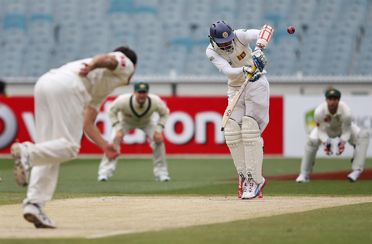 MELBOURNE, AUSTRALIA - DECEMBER 28:  Mitchell Johnson of Australia dismisses Tillakaratne Dilshan of Sri Lanka who was caught by Ed Cowan during day three of the Second Test match between Australia and Sri Lanka at Melbourne Cricket Ground on December 28, 2012 in Melbourne, Australia.  (Photo by Michael Dodge/Getty Images)