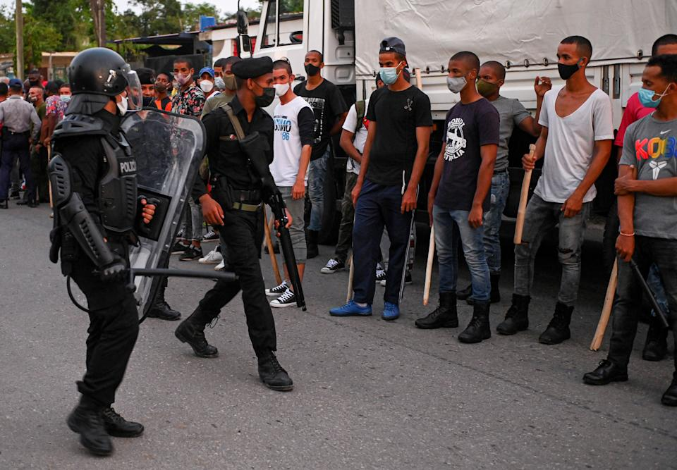 Riot police walk the streets after a demonstration against the government of President Miguel Diaz-Canel in Arroyo Naranjo Municipality, Havana on July 12, 2021. - Cuba on Monday blamed a