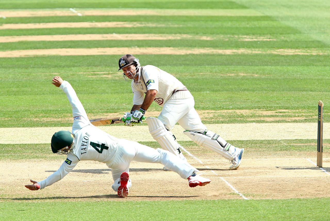 <p>Ricky Ponting of Surrey sees James Taylor of Nottinghamshire come close to a catch as he plays the ball to mid-wicket during the LV County Championship match between Surrey and Nottinghamshire at The Kia Oval on July 11, 2013 in London, England. </p>