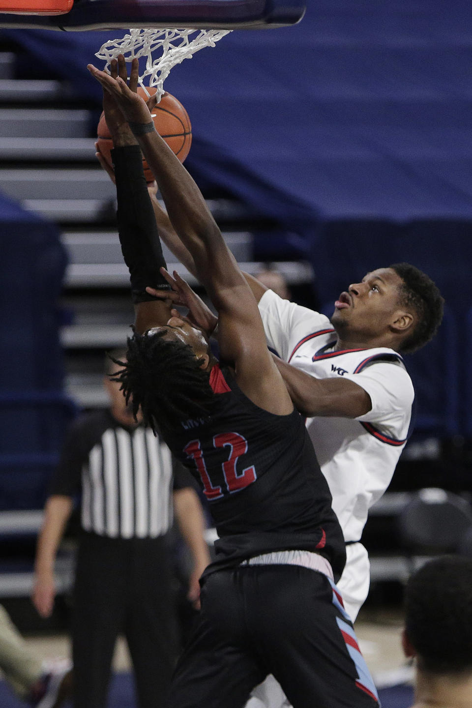 Gonzaga guard Joel Ayayi, right, shoots over Loyola Marymount guard Jalin Anderson during the second half of an NCAA college basketball game in Spokane, Wash., Saturday, Feb. 27, 2021. (AP Photo/Young Kwak)