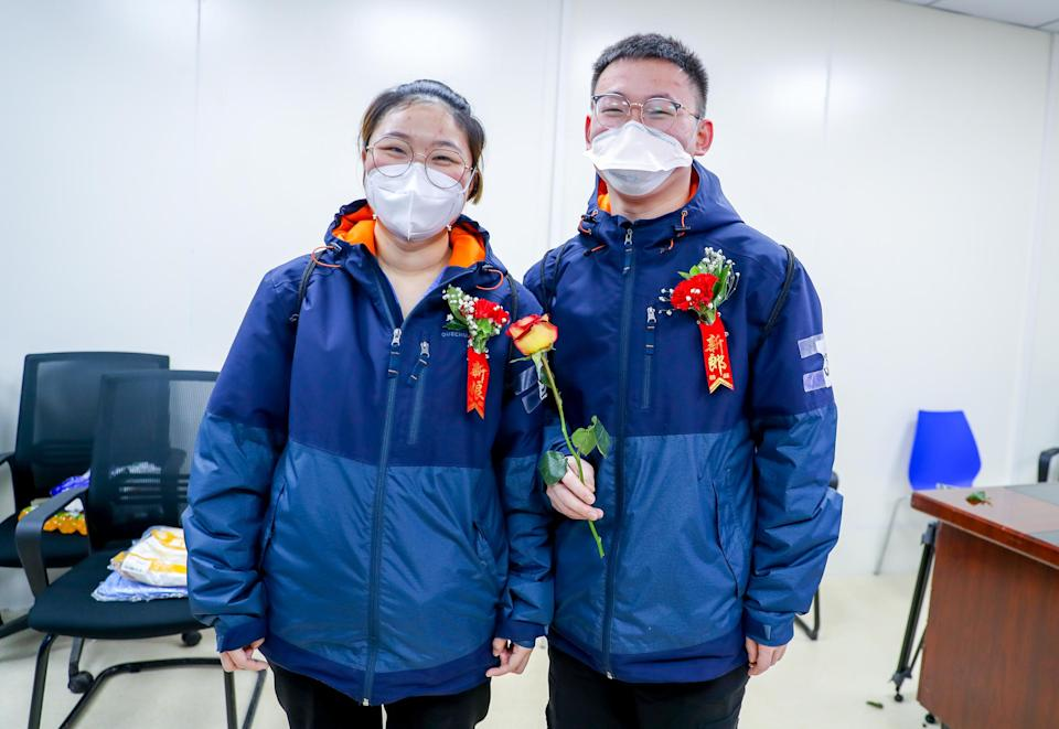 WUHAN, CHINA - FEBRUARY 28: 25-year-old bridegroom Yu Jinghai and 24-year-old bride Zhou Lingyi take part in their wedding ceremony at Leishenshan (Thunder God Mountain) makeshift hospital on February 28, 2020 in Wuhan, Hubei Province of China. Yu and Zhou are both nurses from Shanghai Renji Hospital. They have worked in Wuhan for 10 days and their wedding ceremony was scheduled to take place in Shanghai today. (Photo by Zhang Chang/China News Service via Getty Images)