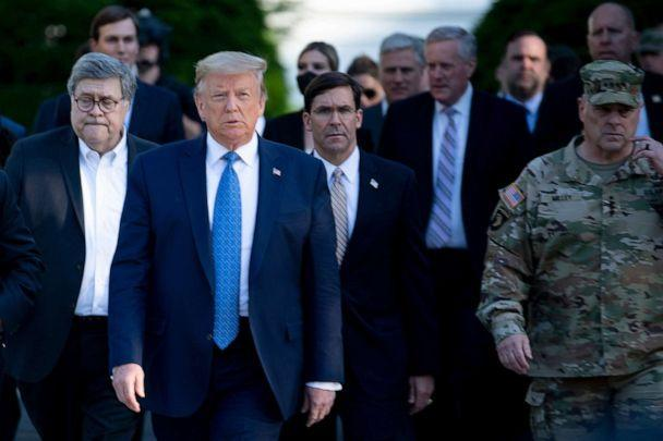 PHOTO: President Donald Trump walks with Attorney General William Barr, left, Secretary of Defense Mark T. Esper, center, Chairman of the Joint Chiefs of Staff Mark A. Milley, right, to St. John's Church after demonstrators were cleared, June 1, 2020. (Brendan Smialowski/AFP via Getty Images, FILE)