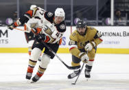 Vegas Golden Knights right wing Alex Tuch (89) steals the puck from Anaheim Ducks defenseman Hampus Lindholm (47) during the first period of an NHL hockey game Saturday, Jan. 16, 2021, in Las Vegas. (AP Photo/Isaac Brekken)