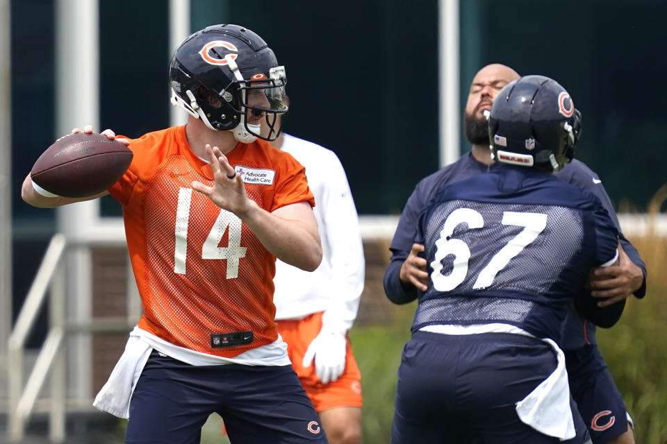 Chicago Bears quarterback Andy Dalton (14) looks to pass during NFL football practice in Lake Forest, Ill., Wednesday, July 28, 2021. (AP Photo/Nam Y. Huh)