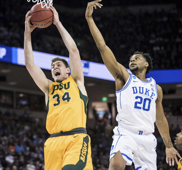 North Dakota State forward Rocky Kreuser (34) grabs a rebound next to Duke center Marques Bolden (20) during the first half of a first-round game in the NCAA mens college basketball tournament Friday, March 22, 2019, in Columbia, S.C. (AP Photo/Sean Rayford)