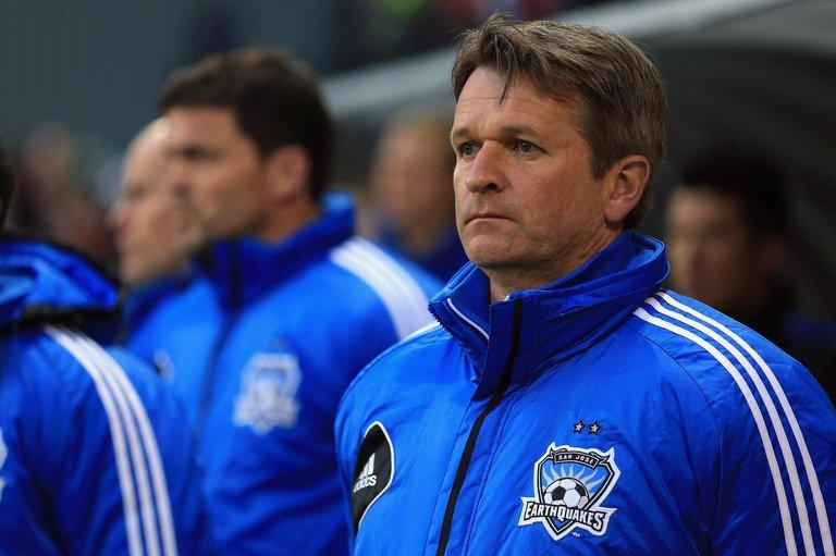 San Jose Earthquakes' Frank Yallop stands for the  anthem before a game against the Portland Timbers, April 14, 2013