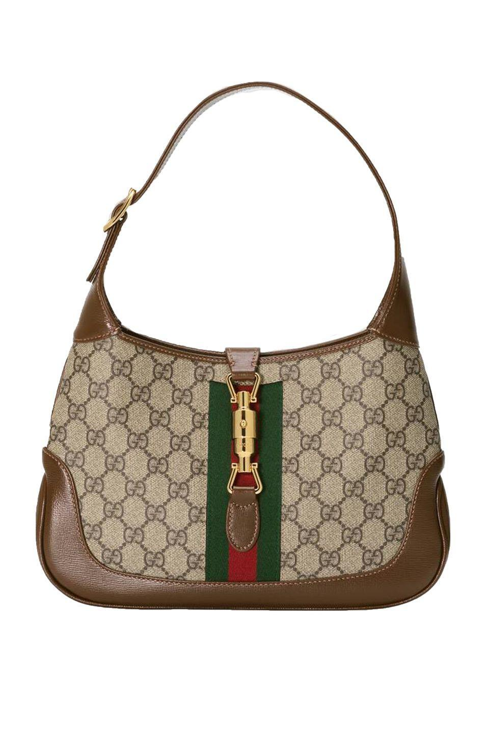 "<p>Get ready for the newest it-throwback<em>. </em>Gucci is revisiting The Jackie, which made its comeback on the Fall 2020 runway. Often seen on by Jackie Kennedy in the '60s—hence its name—the shoulder tote is our top suggestion for practical types. From a wearable shape that fits comfortable under your arm to its timeless GG Supreme print, The Jackie is well-deserving of a renaissance. <br></p><p> <em>Gucci, $1,750; gucci.com</em></p><p><a class=""link rapid-noclick-resp"" href=""https://go.redirectingat.com?id=74968X1596630&url=https%3A%2F%2Fwww.gucci.com%2Fus%2Fen%2Fst%2Fcapsule%2Fjackie-1961&sref=https%3A%2F%2Fwww.elle.com%2Ffashion%2Fshopping%2Fg33416567%2Fdesigner-it-bags-pre-fall-2021%2F"" rel=""nofollow noopener"" target=""_blank"" data-ylk=""slk:SHOP NOW"">SHOP NOW</a></p>"