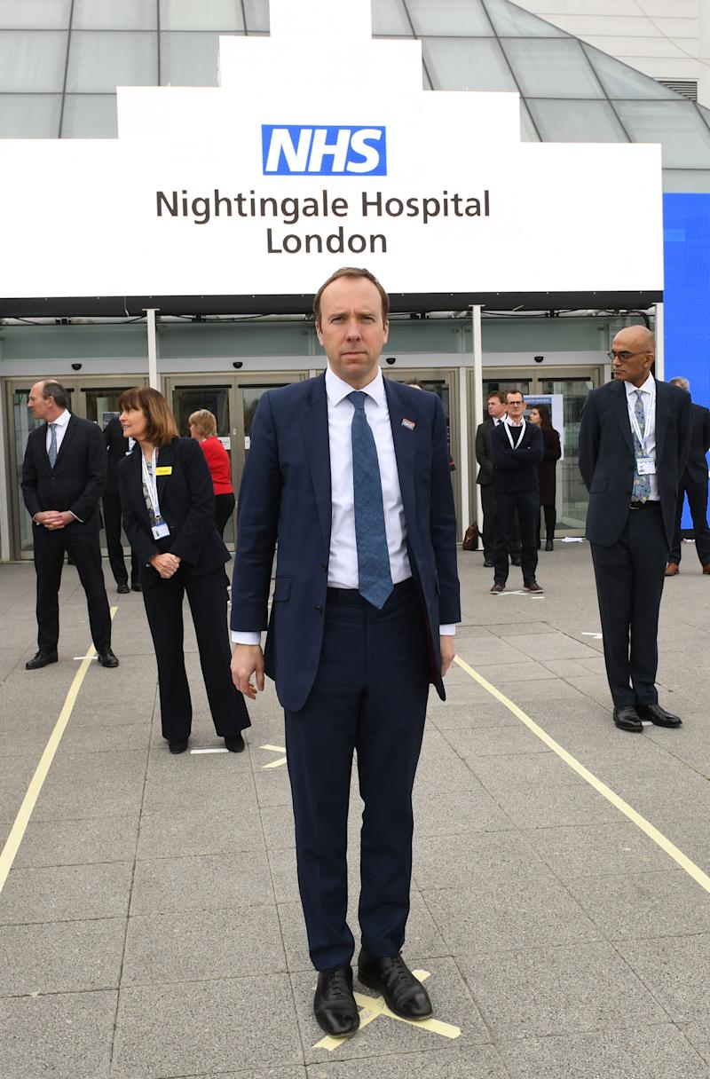 Health secretary Matt Hancock and NHS staff stand on marks on the ground to ensure social distancing guidelines are adhered to at the opening of the NHS Nightingale Hospital at the Excel centre in London (Photo: PA)