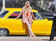 <p>Heidi Klum models on the side of a vintage yellow sports car outside of <em>America's Got Talent</em> on Tuesday in Pasadena. </p>