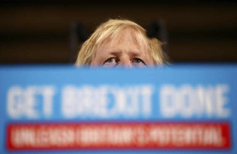 Britain's Prime Minister Boris Johnson attends a rally event as part of the General Election campaign, in Colchester, England, Monday, Dec. 2, 2019. British Prime Minister Boris Johnson and main opposition Labour Party leader Jeremy Corbyn paused to honor the two people killed in the London Bridge attack, then went back to trading blame for the security failings that allowed a man who had been jailed for terrorist crimes to go on a violent rampage in the heart of London. (Hannah McKay/Pool Photo via AP)