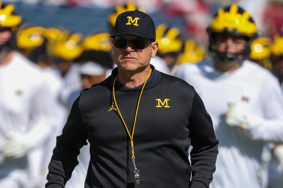 Michigan Wolverines head coach Jim Harbaugh runs off the field during warmups before a game on Jan. 1, 2020. (Joe Petro/Icon Sportswire via Getty Images)
