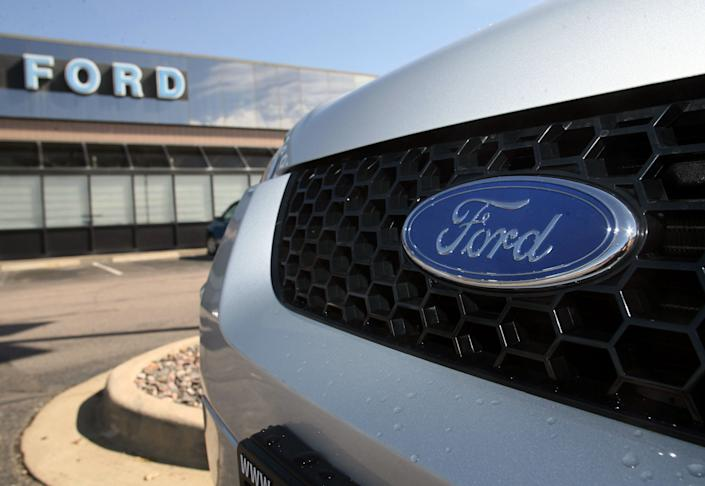 <p> FILE - In this Aug. 20, 2006 file photo, the company logo shines on the grille of a 2006 Ford Escape outside the showroom of a Ford dealership in the south Denver suburb of Littleton, Colo. Ford Motor Co. has signed a deal to distribute vehicles in Myanmar, the head of Ford's local partner said Thursday, Feb. 28, 2013. (AP Photo/David Zalubowski, File) </p>