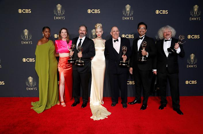 Actors Moses Ingram, Marielle Heller and Anya Taylor-Joy pose for a picture along with producers Scott Frank, Allan Scott, Mick Ancieto and Marcus Loges, with their awards for