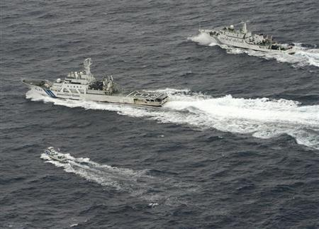 Chinese marine surveillance ship Haijian No. 66 tries to approach a Japanese fishing boat in the East China Sea