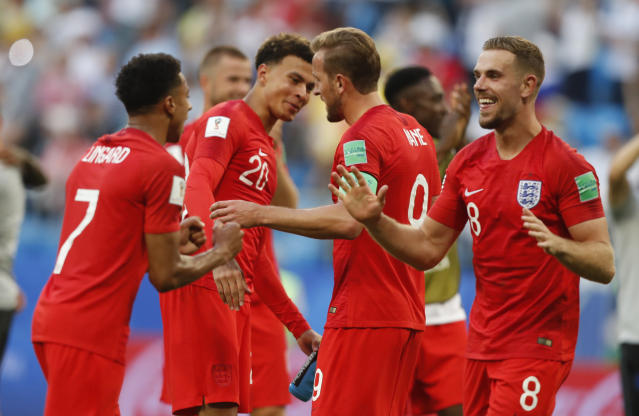 <p>England team players celebrate their victory over Sweden </p>