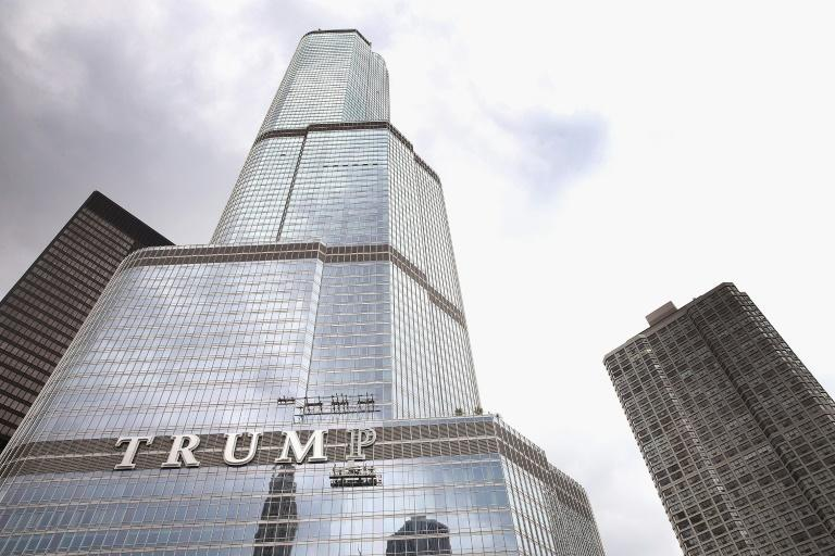 Trump Tower in Chicago is emblazoned with President Donald Trump's name, but many companies are cutting ties with the leader in an 11th-hour stampede