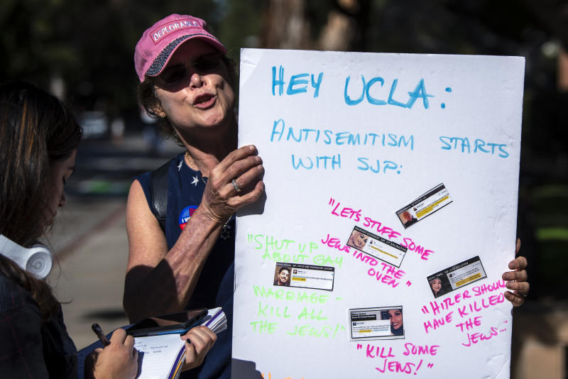 A protester holds a sign during a protest against anti-Semitism and the upcoming National Students for Justice in Palestine conference at the UCLA campus in Los Angeles, California on November 6, 2018. The Los Angeles City Council called on UCLA to cancel the NSJP conference over fears that it will promote anti-Semitism. (Photo: Ronen Tivony/NurPhoto via Getty Images)