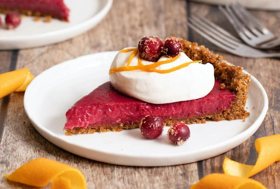 """<p>This cranberry curd tart is certainly the type of <a href=""""https://www.thedailymeal.com/cook/15-most-difficult-impressive-desserts-make-slideshow?referrer=yahoo&category=beauty_food&include_utm=1&utm_medium=referral&utm_source=yahoo&utm_campaign=feed"""" rel=""""nofollow noopener"""" target=""""_blank"""" data-ylk=""""slk:dessert that will impress your guests"""" class=""""link rapid-noclick-resp"""">dessert that will impress your guests</a>. Its light texture and gingersnap crust might just take the cake over pumpkin pie this year.</p> <p><a href=""""https://www.thedailymeal.com/recipes/cranberry-curd-tart-recipe?referrer=yahoo&category=beauty_food&include_utm=1&utm_medium=referral&utm_source=yahoo&utm_campaign=feed"""" rel=""""nofollow noopener"""" target=""""_blank"""" data-ylk=""""slk:For the Cranberry Curd Tart recipe, click here."""" class=""""link rapid-noclick-resp"""">For the Cranberry Curd Tart recipe, click here.</a></p>"""