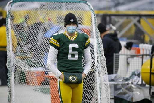 Green Bay Packers' J.K. Scott wears a mask on the sidelines during the first half of an NFL football game against the Jacksonville Jaguars Sunday, Nov. 15, 2020, in Green Bay, Wis. (AP Photo/Mike Roemer)