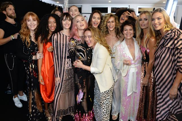 Charlotte Tilbury, Corinne Bailey Rae, Sam Rollinson, Mary Charteris, Olga Kurylenko, Alice Temperley, Alice Dellal, Nathalie Emmanuel, Helen McCrory, Ellen von Unwerth, Laura Bailey and Arizona Muse pose backstage at the Temperley London SS19 catwalk show. [Photo: Getty]