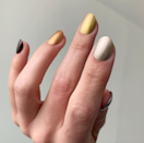 """Another good option for the minimalists out there. Nail artist Stephanie Stone used Essie in <a href=""""https://www.amazon.com/essie-polish-seeing-stars-shimmer/dp/B075FJS2YZ"""" rel=""""nofollow noopener"""" target=""""_blank"""" data-ylk=""""slk:Seeing Stars"""" class=""""link rapid-noclick-resp"""">Seeing Stars</a>, <a href=""""https://www.essie.com/nail-polish/color-and-care/metallics/pep-in-your-rep"""" rel=""""nofollow noopener"""" target=""""_blank"""" data-ylk=""""slk:Pep in Your Rep"""" class=""""link rapid-noclick-resp"""">Pep in Your Rep</a>, <a href=""""https://www.amazon.com/Essie-Million-Mile-Hues-0-5/dp/B07K7VN1VB"""" rel=""""nofollow noopener"""" target=""""_blank"""" data-ylk=""""slk:Million Mile Hues"""" class=""""link rapid-noclick-resp"""">Million Mile Hues</a>, <a href=""""https://www.essie.com/nail-polish/enamel/metallics/good-as-gold"""" rel=""""nofollow noopener"""" target=""""_blank"""" data-ylk=""""slk:Good as Gold"""" class=""""link rapid-noclick-resp"""">Good as Gold</a>, and <a href=""""https://www.amazon.com/essie-Serene-polish-collection-gadget-free/dp/B07KYP7B6C"""" rel=""""nofollow noopener"""" target=""""_blank"""" data-ylk=""""slk:Gadget Free"""" class=""""link rapid-noclick-resp"""">Gadget Free</a> for this look."""