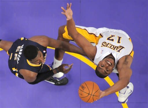Los Angeles Lakers center Andrew Bynum, right, grabs a rebound as Indiana Pacers center Roy Hibbert defends during the first half of their NBA basketball game, Sunday, Jan. 22, 2012, in Los Angeles, Calif. (AP Photo/Mark J. Terrill)
