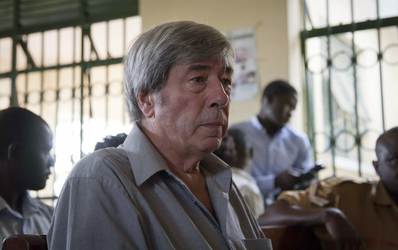 Briton Bernard Randall, 65, who is being charged with trafficking in obscene publications, attends a trial hearing which was postponed until December, in Entebbe, Uganda Monday, Nov. 18, 2013. Randall, who told journalists that he was innocent but worried about the court proceedings in Uganda where homosexuality is illegal under Ugandan law and gay leaders say their community is often persecuted, was arrested after images of him having gay sex were published following the theft of his laptop computer and faces up to two years in prison if convicted. (AP Photo/Rebecca Vassie)