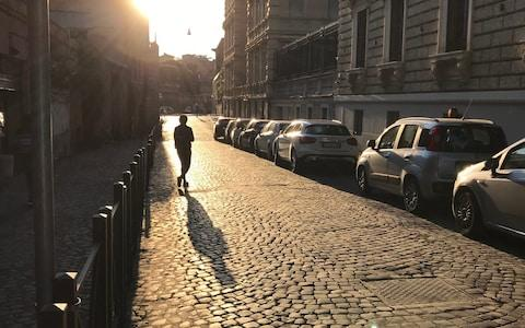 Early morning sunshine hits a road lined with cobbles in the historic heart of Rome - Credit: Nick Squires