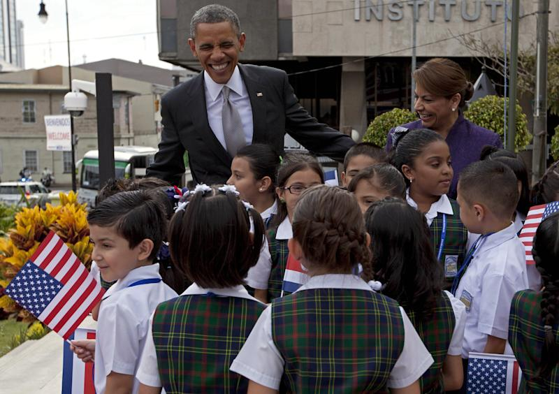 President Barack Obama and Costa Rica's President Laura Chinchilla visit with a group of students upon his arrival to the foreign ministry, Casa Amarilla, in San Jose, Costa Rica, Friday, May 3, 2013. Obama's three-day visit to Mexico and Costa Rica is his first to Latin America since winning re-election. (AP Photo/Moises Castillo)