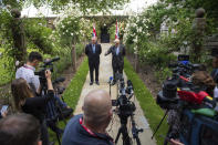 Britain's Prime Minister Boris Johnson,centre right, and Australian Prime Minister Scott Morrison pose for the media, after their meeting, in the garden of 10 Downing Streeet, in London, Tuesday June 15, 2021. Britain and Australia have agreed on a free trade deal that will be released later Tuesday, Australian Trade Minister Dan Tehan said. (Dominic Lipinski/Pool Photo via AP)