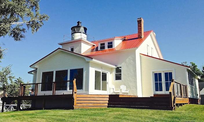 """Dating back to the 1850s, the Eagle River lighthouse has been restored with care and outfitted with all the modern amenities, including WiFi and a food lover's kitchen. You can take in a breeze from Lake Superior on the deck, stroll to the beach, or admire the view from the tower. $450, Airbnb. <a href=""""https://www.airbnb.com/rooms/31710067"""" rel=""""nofollow noopener"""" target=""""_blank"""" data-ylk=""""slk:Get it now!"""" class=""""link rapid-noclick-resp"""">Get it now!</a>"""