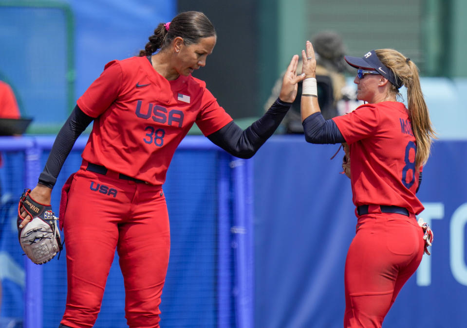 United States' Cat Osterman reacts with teammate Haylie McCleney, right, during the softball game between Italy and the United States at the 2020 Summer Olympics, Wednesday, July 21, 2021, in Fukushima , Japan. (AP Photo/Jae C. Hong)