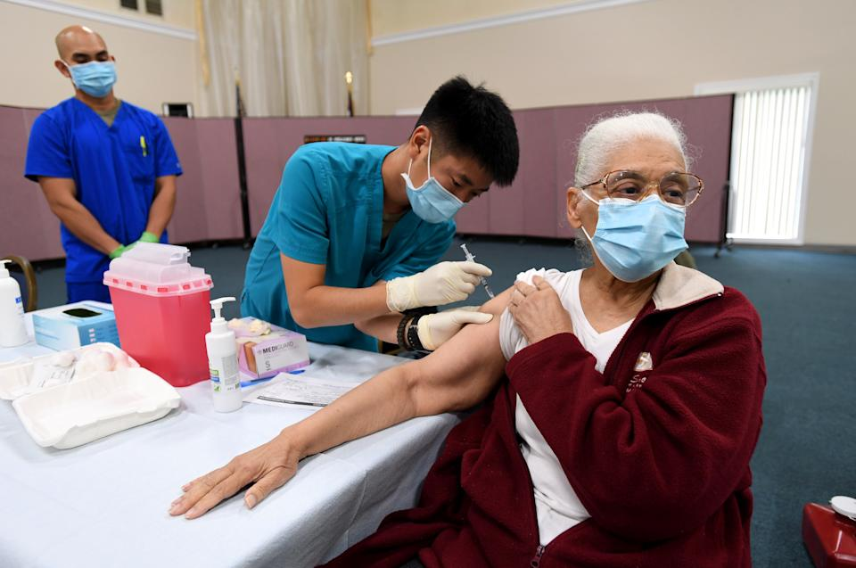LONG BEACH, CA - FEBRUARY 10: Zemoria Harvey, 77, gets her first dose of the COVID-19 vaccine from EMT Sohei Yamaguchi at St. Mark Baptist Church in Long Beach on Wednesday, February 10, 2021. The mobile vaccine clinic focused on Black seniors as one way to help address equity in the city's coronavirus inoculation program. (Photo by Brittany Murray/MediaNews Group/Long Beach Press-Telegram via Getty Images)