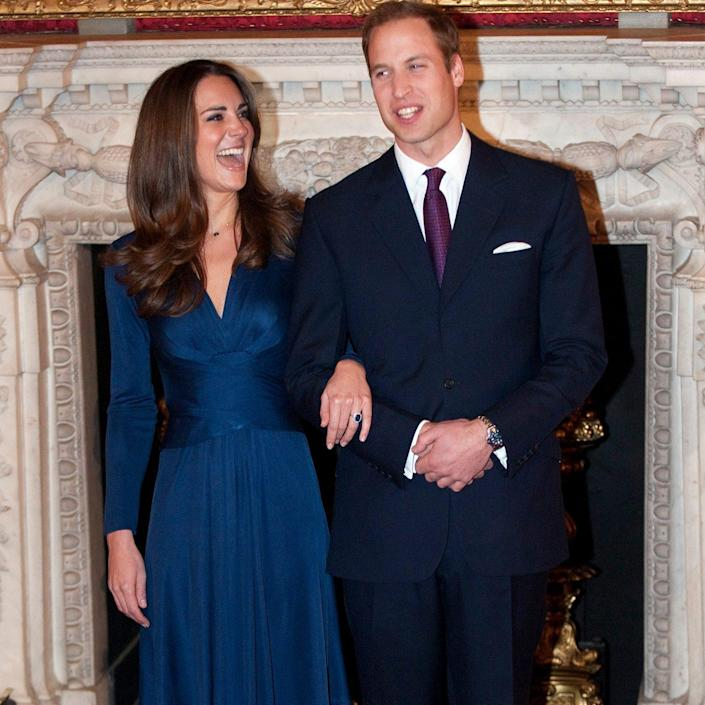 Kate Middleton wearing the sapphire blue Issa dress on the day her engagement to Prince William was announced - Eddie Mulholland