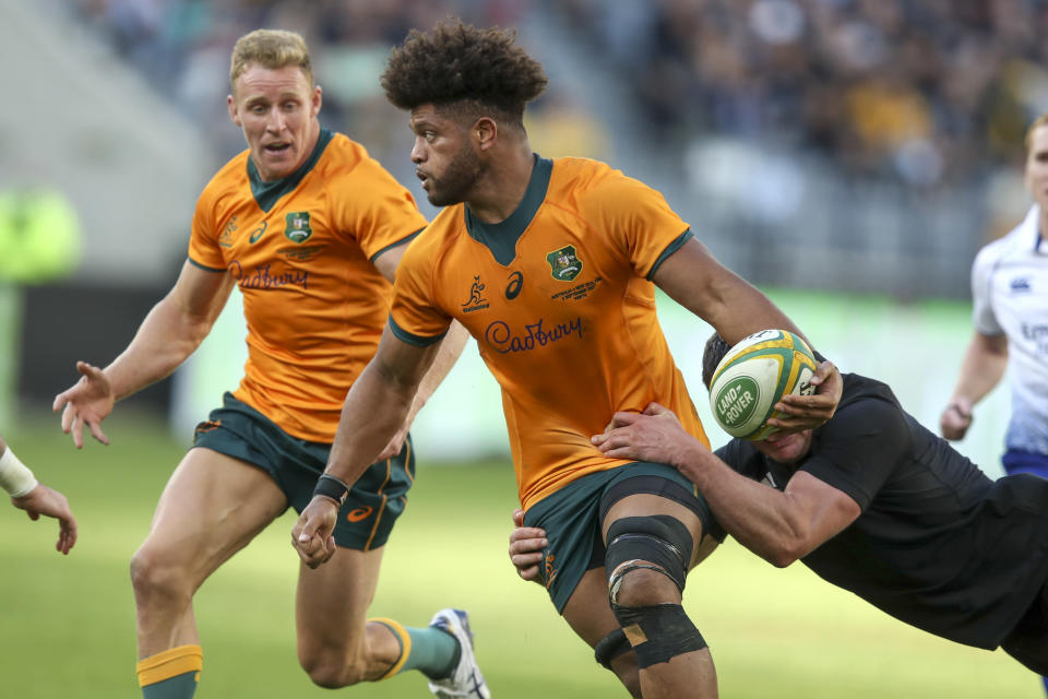 Australia's Rob Valetini runs at the defense during the Rugby Championship game between the All Blacks and the Wallabies in Perth, Australia, Sunday, Sept. 5, 2021. (AP Photo/Gary Day)
