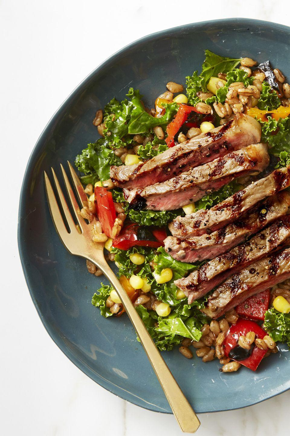 """<p>Thanks to a colorful veggie medley, this steak salad ticks off all the healthy boxes.</p><p><a href=""""https://www.goodhousekeeping.com/food-recipes/easy/a44226/summer-farro-salad-grilled-steak-recipe/"""" rel=""""nofollow noopener"""" target=""""_blank"""" data-ylk=""""slk:Get the recipe for Summer Farro Salad with Grilled Steak »"""" class=""""link rapid-noclick-resp""""><em>Get the recipe for Summer Farro Salad with Grilled Steak »</em></a></p>"""