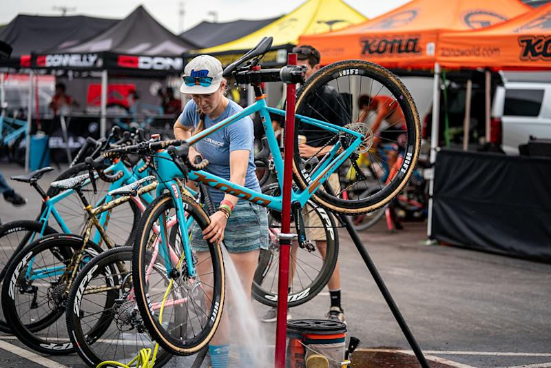 Brenna Wrye-Simpson cleaning off the bikes